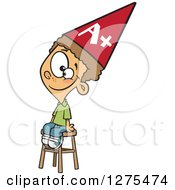 Cartoon Clipart Of A Happy Smart Caucasian Boy Wearing An Anti Dunce Hat And Sitting On A Stool Royalty Free Vector Illustration