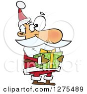 Cartoon Clipart Of A Happy Santa Claus Holding A Christmas Gift Royalty Free Vector Illustration