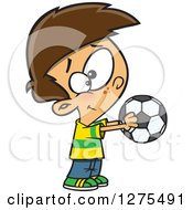 Cartoon Clipart Of A Happy Caucasian Boy Holding Out A Soccer Ball Royalty Free Vector Illustration by toonaday