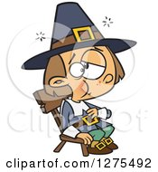 Cartoon Clipart Of A Stuffed Caucasian Pilgrim Boy Sitting And Rubbing His Tummy Royalty Free Vector Illustration