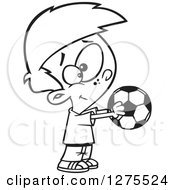 Cartoon Clipart Of A Black And White Happy Boy Holding Out A Soccer Ball Royalty Free Vector Line Art Illustration by toonaday