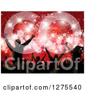 Clipart Of A Silhouetted Group Of People Dancing At A Christmas Party Over Red With Snowflakes And Sparkles Under Merry Christmas And A Happy New Year Text Royalty Free Vector Illustration by KJ Pargeter