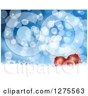 Clipart Of A Christmas Background Of 3d Red Ornaments Over Snow And Blue Bokeh Royalty Free Illustration