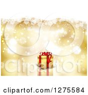 Clipart Of A 3d Christmas Gift Over A Gold Snowflake And Flare Background Royalty Free Vector Illustration