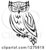 Clipart Of A Black And White Resting Owl Royalty Free Vector Illustration