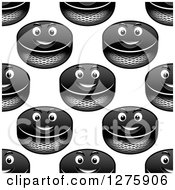 Clipart Of A Seamless Pattern Background Of Grinning Hockey Pucks Royalty Free Vector Illustration