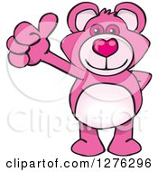 Clipart Of A Pink Teddy Bear Holding A Thumb Up Royalty Free Vector Illustration