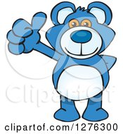 Clipart Of A Blue Teddy Bear Holding A Thumb Up Royalty Free Vector Illustration