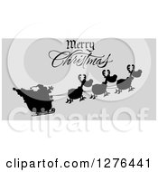 Clipart Of A Merry Christmas Greeting Over A Black Silhouetted Santa And Flying Reindeer On Gray Royalty Free Vector Illustration