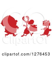 Red Silhouetted Santa Reindeer And Elf With A Christmas Sack And Gifts