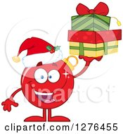 Clipart Of A Happy Red Christmas Bauble Ornament Character Holding Up Gifts Royalty Free Vector Illustration by Hit Toon