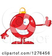 Clipart Of A Happy Red Christmas Bauble Ornament Character Winking And Giving A Thumb Up Royalty Free Vector Illustration by Hit Toon
