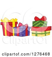 Clipart Of Four Colorful Christmas Or Birthday Presents Royalty Free Vector Illustration by Hit Toon