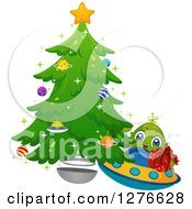 Clipart Of A Happy Cute Alien Boy Flying A UFO With A Gift By A Christmas Tree Royalty Free Vector Illustration