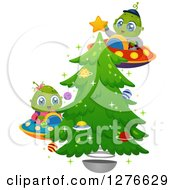 Clipart Of Happy Cute Alien Kids Flying UFOs And Decorating A Christmas Tree Royalty Free Vector Illustration by BNP Design Studio