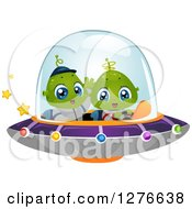 Clipart Of A Happy Cute Alien Kids Flying A UFO Royalty Free Vector Illustration