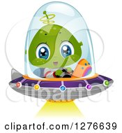 Clipart Of A Happy Cute Alien Boy Flying A UFO With A Shining Light Royalty Free Vector Illustration