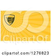 Clipart Of A Retro Cougar And Yellow Rays Business Card Design Royalty Free Illustration by patrimonio