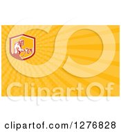Clipart Of A Retro Woodcut Spray Painter And Yellow Rays Business Card Design Royalty Free Illustration by patrimonio