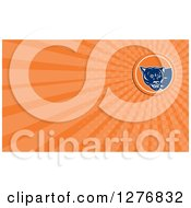 Clipart Of A Retro Cougar And Orange Rays Business Card Design Royalty Free Illustration by patrimonio