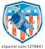 Clipart Of A Retro Woodcut Male Rodeo Cowboy On A Bucking Bull In An American Flag Shield Royalty Free Vector Illustration