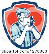 Clipart Of A Retro Male Camera Man Filming In A Blue White And Red Shield Royalty Free Vector Illustration