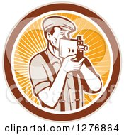 Clipart Of A Retro Male Camera Man Filming In A Tan Brown White And Orange Ray Circle Royalty Free Vector Illustration