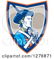 Clipart Of A Retro American Patriot Soldier With A Musket In An Orange Blue White And Taupe Shield Royalty Free Vector Illustration