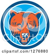 Clipart Of A Retro Woodcut Grizzly Bear Head In A Blue And White Circle Royalty Free Vector Illustration