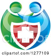 Clipart Of A Blue And Green People Hugging Over A Medical Cross Shield Royalty Free Vector Illustration by Lal Perera