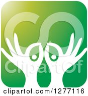 Clipart Of White Silhouetted Hands And Pills In A Green Icon Royalty Free Vector Illustration
