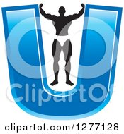 Clipart Of A Flexing Black And White Male Bodybuilder Stretching Out A Blue Letter U Royalty Free Vector Illustration by Lal Perera