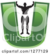Clipart Of A Flexing Black And White Male Bodybuilder Stretching Out A Green Letter U Royalty Free Vector Illustration by Lal Perera