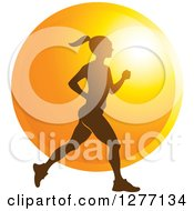 Clipart Of A Silhouetted Woman Running Over A Sunset Circle Royalty Free Vector Illustration