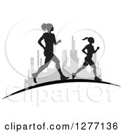 Clipart Of Silhouetted Women Running Over A Grayscale City Royalty Free Vector Illustration