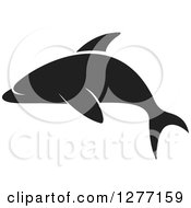 Clipart Of A Black And White Silhouetted Dolphin Royalty Free Vector Illustration by Lal Perera