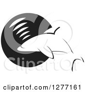 Clipart Of A Black And White Dolphin Making Sounds Over A Circle Royalty Free Vector Illustration by Lal Perera