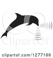 Clipart Of A Black Silhouetted Dolphin Making Sounds Royalty Free Vector Illustration by Lal Perera