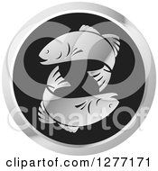 Clipart Of A Round Black And Silver Fish Logo Royalty Free Vector Illustration by Lal Perera