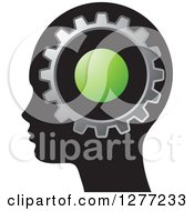 Clipart Of A Black Silhouetted Womans Head With A Green Dot And Gear Royalty Free Vector Illustration