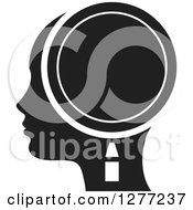 Clipart Of A Black Silhouetted Womans Head In Profile With A Magnifying Glass Royalty Free Vector Illustration