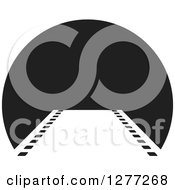 Clipart Of A Film Strip Leading To A Black Circle Royalty Free Vector Illustration by Lal Perera