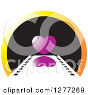 Clipart Of A Film Strip Leading To A Heart On A Black And Gradient Orange Circle Royalty Free Vector Illustration by Lal Perera