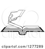 Clipart Of A Black And White Hand Turning A Book Page Royalty Free Vector Illustration by Lal Perera