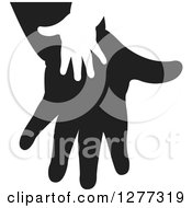 Clipart Of A White Silhouetted Childs Hand On A Black Parents Hand Royalty Free Vector Illustration by Lal Perera