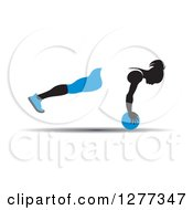 Clipart Of A Black Silhouetted Woman Exercising And Balancing With A Blue Medicine Ball Royalty Free Vector Illustration