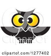 Clipart Of A Black Owl With Big Yellow Eyes Royalty Free Vector Illustration