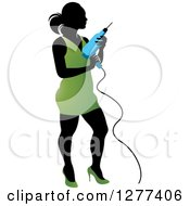 Clipart Of A Black Silhouetted Woman In A Green Dress Holding A Power Drill Royalty Free Vector Illustration by Lal Perera