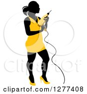 Clipart Of A Black Silhouetted Woman In A Yellow Dress Holding A Power Drill Royalty Free Vector Illustration by Lal Perera