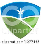 Clipart Of A Green And Blue Sky And Hill Shield With A Tree Royalty Free Vector Illustration by Lal Perera